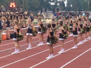 Cheerleaders lead the crowd on with praises for the team.