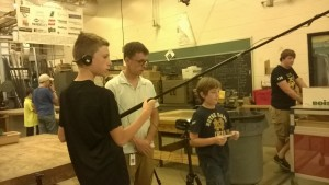 Jack, Orlando and McNulty are busy interviewing campers in the robotics lab.
