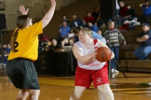 Special Olympics athletes play basketball