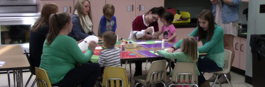 Penn students help youngsters ages 4-5 make crafts in the Child Development program.