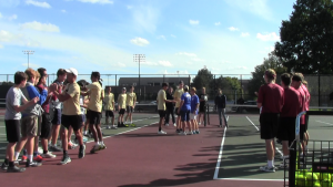 One team of doubles from Penn meet their opponents from Marian High School.